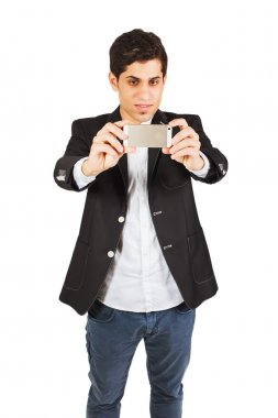 Young man with a phone on the white background