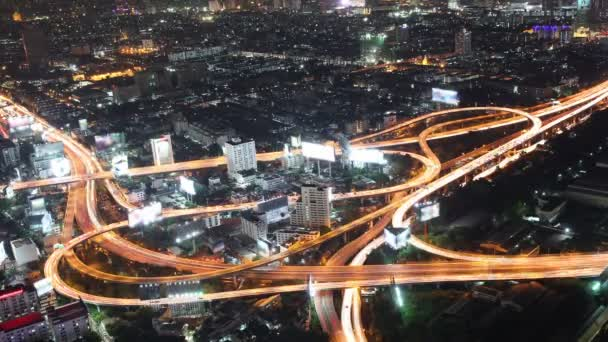 Cityscape traffic light night on highway road, Time lapse Bangkok bird eye view with wide-angle