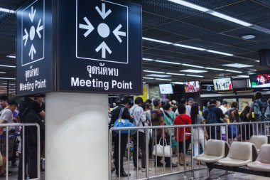 BANGKOK THAILAND - FEBRUARY 17 : The meeting point sign and busi