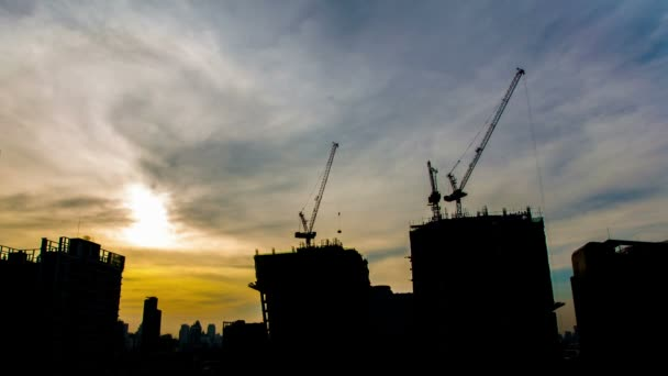 timelapse,Group of worker are building construction or mall, teamwork concept taken at twilight scene as day to night, wide-angle view