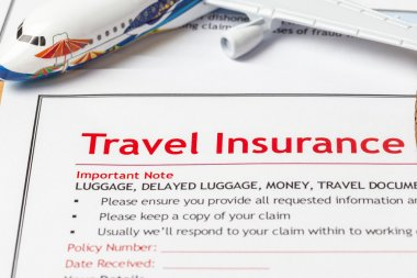Travel Insurance Claim application form on brown envelope, busin