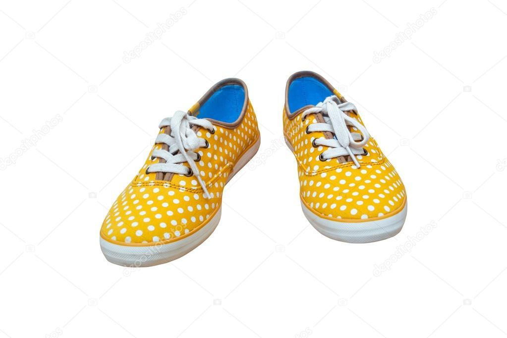 c23eea0e717 Ζευγάρι πάνινα παπούτσια, εκλεκτής ποιότητας dot κίτρινο χρώμα που  απομονώνονται σε λευκό backg– εικόνα αρχείου