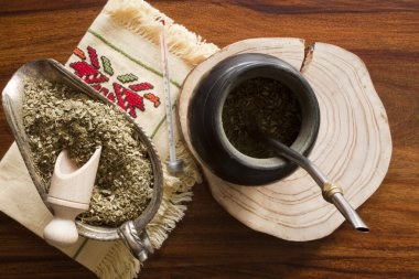yerba mate gourd on wooden table