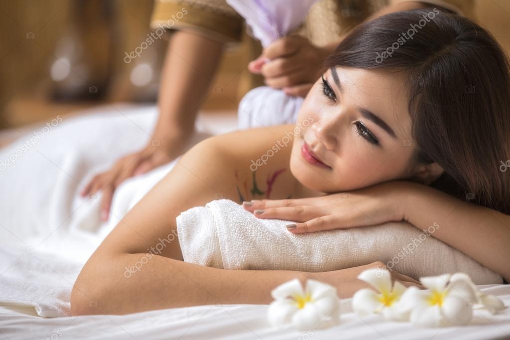 Masseur doing massage on asia woman body