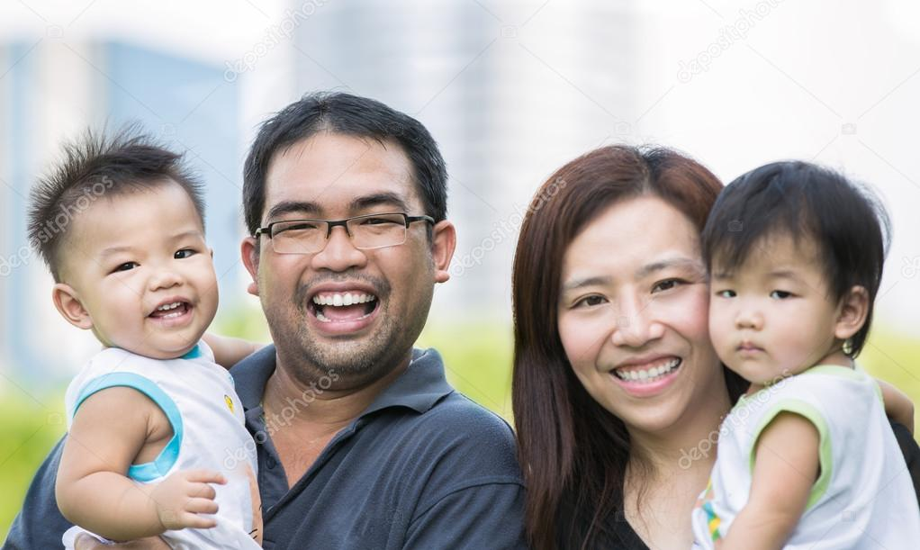 Happy asian mother, father and twins child