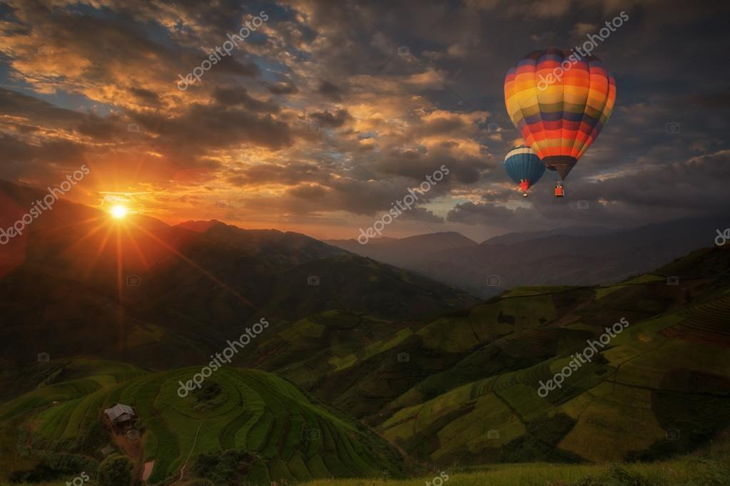 Hot air balloon over Rice fields on terraced