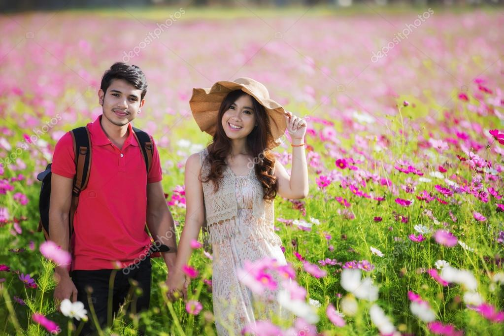 Couples traveling to Cosmos flowers garden