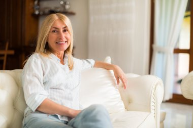 woman relaxing on couch in home
