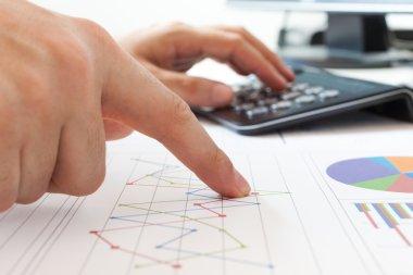 Businessman examining financial charts