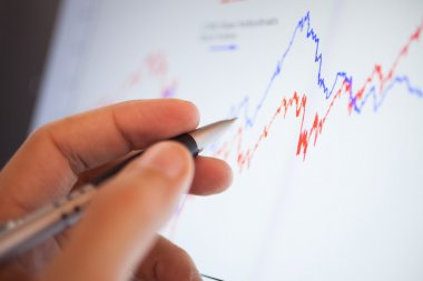 hand and stock market graph
