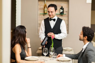 Customers choosing bottle in restaurant