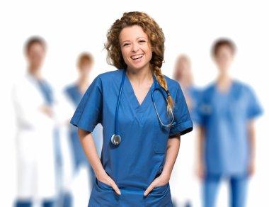 Smiling nurse in front of medical team