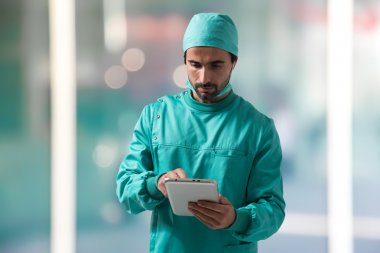 Surgeon using tablet