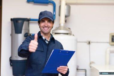 technician servicing hot-water heater