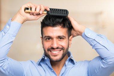 man combing his hair