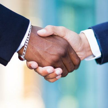 African businessman shaking hands with caucasian