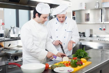 Chefs at work in his Kitchen