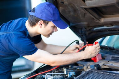 Auto electrician troubleshooting car engine