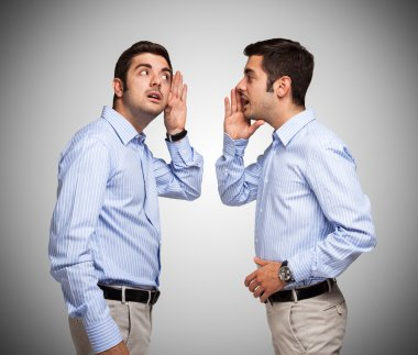 Man talking to clone of himself