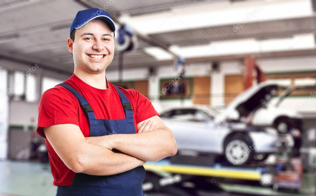 Friendly smiling mechanic