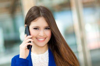 Smiling woman talking on phone