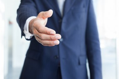 Businessman offering an handshake