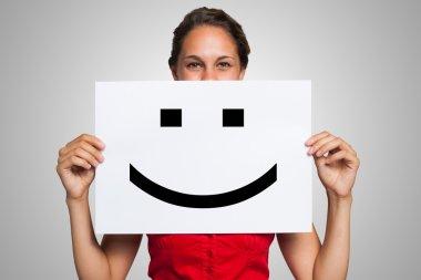 Woman with smiley emoticon