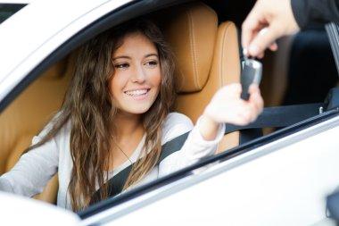 Woman receiving keys of car