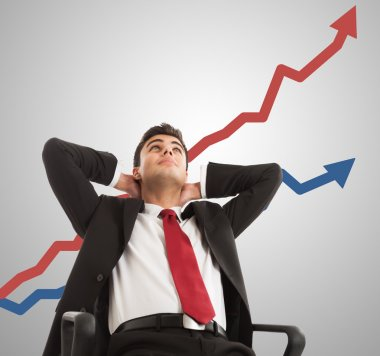 Businessman looking at growing graph