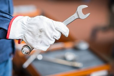 Worker holding wrench