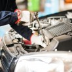 stock-photo-auto-mechanic-at-work-on