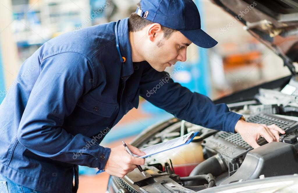 Mechanic at work in garage