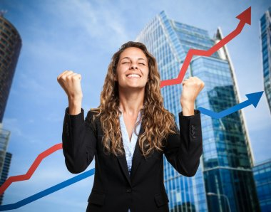 Happy businesswoman and rising arrow