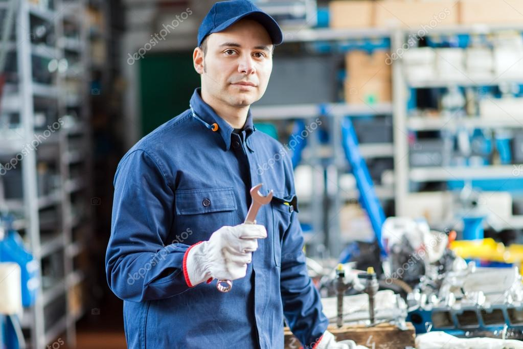 Auto mechanic holding wrench