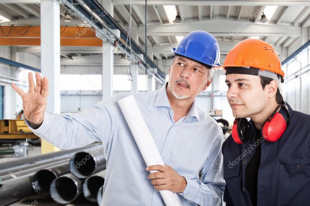Foreman explaining job to worker