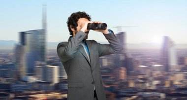 Businessman in search for opportunities on the top of a skyscraper stock vector