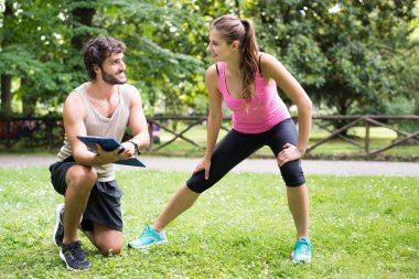 Man showing training program to woman