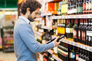 Man choosing wine bottle