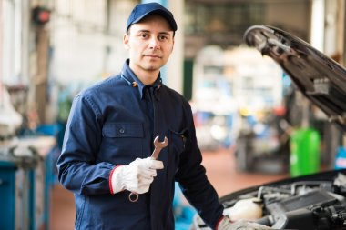Mechanic holding a wrench