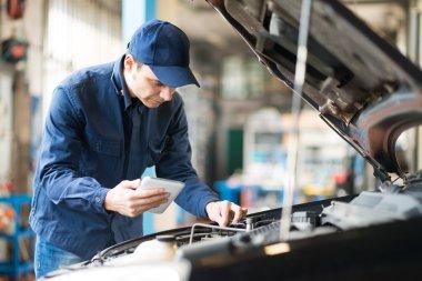 Mechanic using tablet in garage
