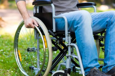 man using wheelchair in park