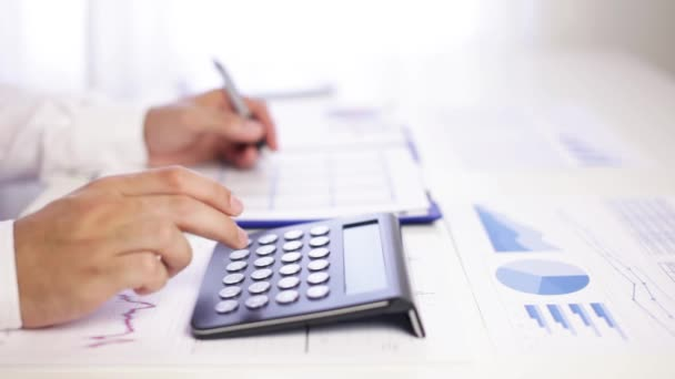 Businessman accounting with graph and calculator