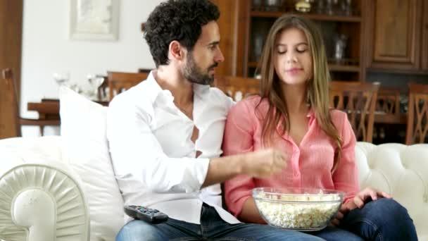 couple eating popcorn