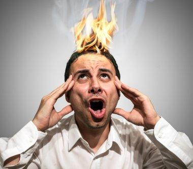 Man having his brain burning up