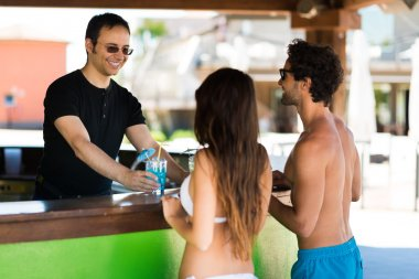 people taking a drink in beach bar