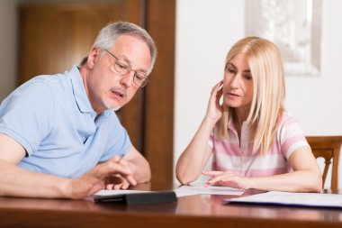 Couple calculating their expenses