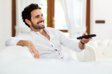 Man choosing the right TV program