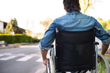 Disabled man preparing to go across road