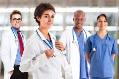 doctor in front of medical workers