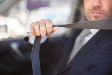 Driver fastening seat belt